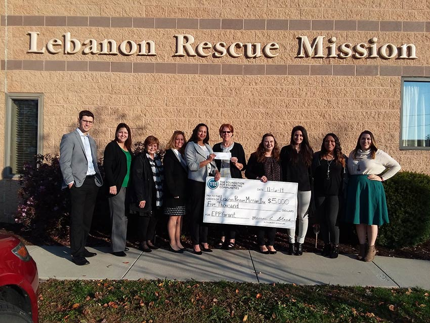 Group of people posing with a grant check.