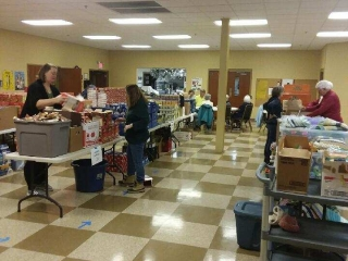 Volunteers putting together gift bags.
