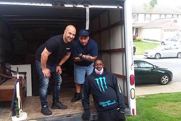 Volunteers unloading a truck